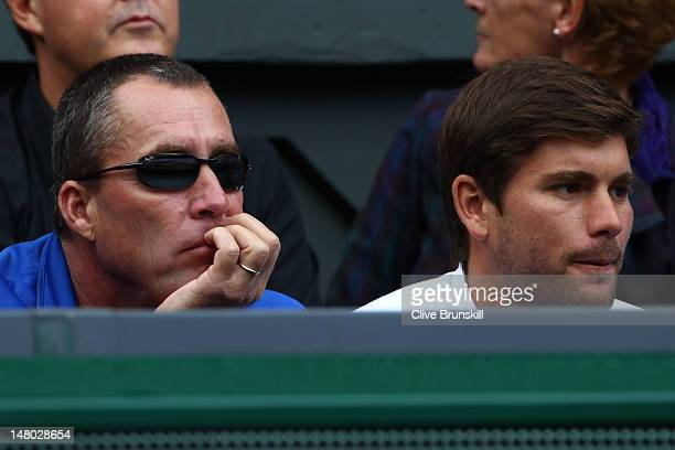 Andy Murray's coach Ivan Lendl and hitting partner Daniel Vallverdu attend the Gentlemen's Singles final match between Roger Federer of Switzerland...