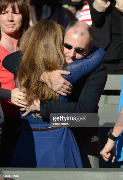 Andy Murray's wife Kim Sears and father William Murray celebrate after Murray wins his semi final match against JoWilfried Tsonga of France at the...