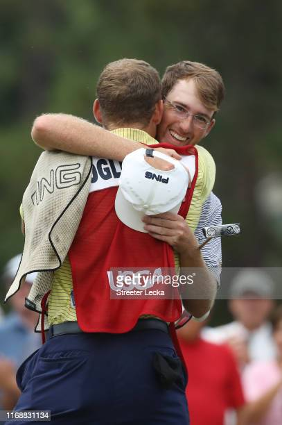 Andy Ogletree celebrates with his caddie Devin Stanton after defeating John Augenstein 21 on the 17th green during the 119th USGA US Amateur...