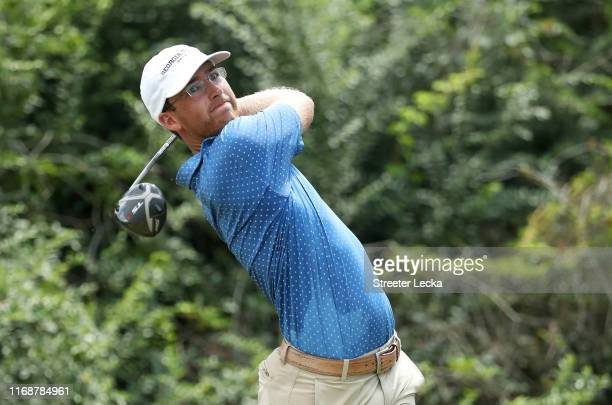 Andy Ogletree hits a tee shot on the 17th hole during the 119th USGA US Amateur Championship 36 hole final at Pinehurst Resort and Country Club on...