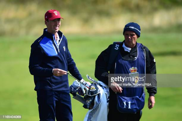 Andy Ogletree of the United States selects a club during a practice round at Royal Birkdale Golf Club prior to the 2019 Walker Cup on September 1...
