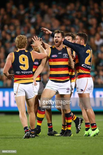 Andy Otten of the Crows is congratulated by teammates after he kicked a goal during the round three AFL match between the Port Adelaide Power and the...
