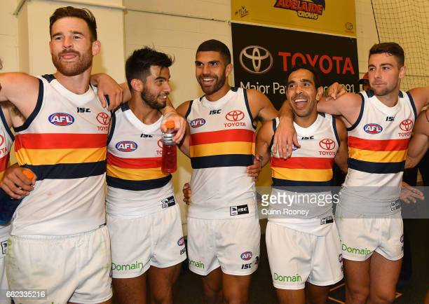 Andy Otten Wayne Milera Curtly Hampton Eddie Betts and Rory Atkins of the Crows sing the song after winning the round two AFL match between the...