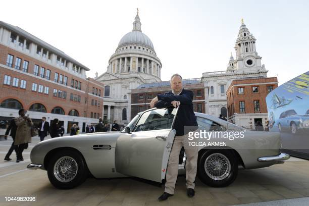 Andy Palmer CEO of Luxury British sports car manufacturer Aston Martin poses by models of Aston Martin cars as the company is floated on the London...