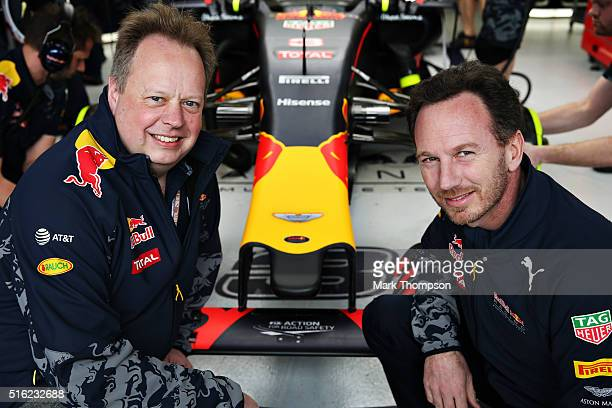 Andy Palmer Chief Executive Officer of Aston Martin and Red Bull Racing Team Principal Christian Horner pose for a photo in the garage during...