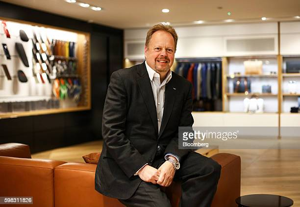 Andy Palmer chief executive officer of Aston Martin Lagonda Ltd poses for a photograph during the launch event for the 'Aston Martin at No 8 Dover...