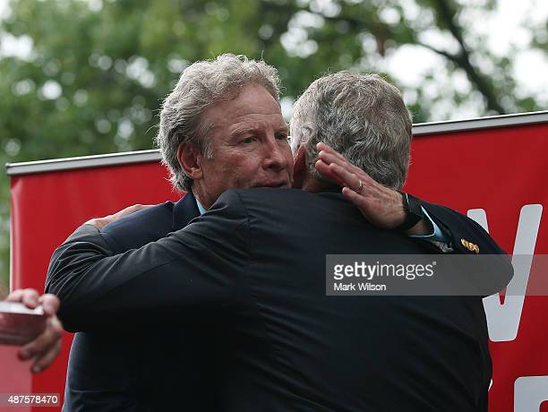 Andy Parker father of murdered TV reporter Alison Parker hugs Virginia Governor Terry McAuliffe during a anti gun rally on Capitol Hill September 10...