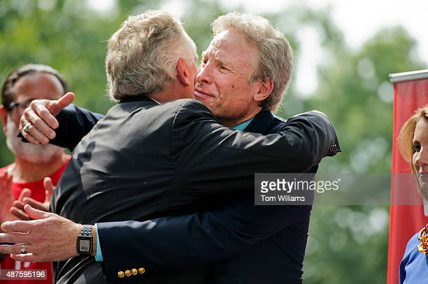 Andy Parker right whose daughter Alison a reporter for WDBJTV reporter was killed on air last month greets Gov Terry McAuliffe DVa during a rally on...