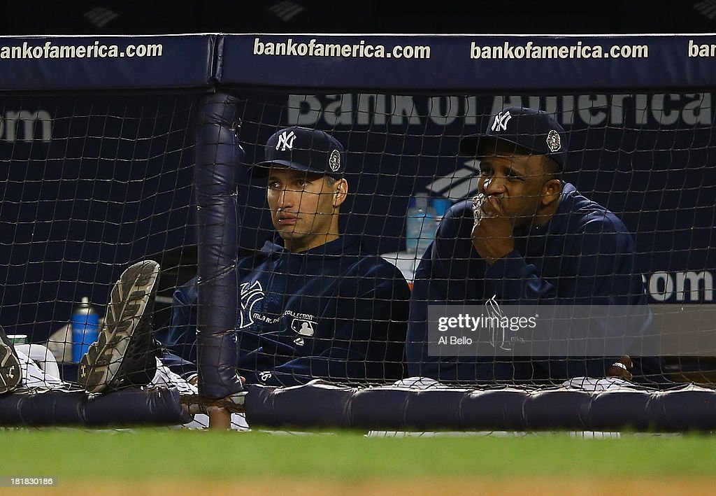 Andy Pettitte #46 and CC Sabathia #52 of the New York Yankees look on at the end of an 8-3 loss to the Tampa Bay Rays during their game on September 25, 2013 at Yankee Stadium in the Bronx borough of New York City.
