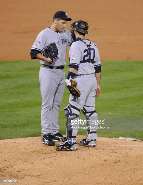 Andy Pettitte and Jorge Posada of the New York Yankees converse on the mound against the Philadelphia Phillies in Game Three of the 2009 MLB World...