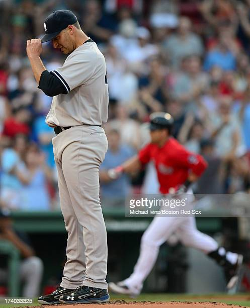 Andy Pettitte of the New York Yankees adjusts his cap after allowing a home run to Jacoby Ellsbury of the Boston Red Sox in the first inning on July...