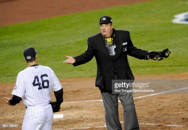 Andy Pettitte of the New York Yankees argues with umpire Joe West during a game against the Philadelphia Phillies during Game Six of the 2009 MLB...