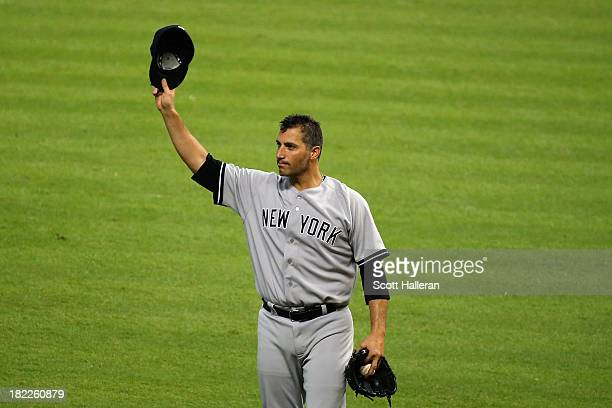 Andy Pettitte of the New York Yankees celebrates after pitching his last game and defeating the Houston Astros 21 at Minute Maid Park on September 28...