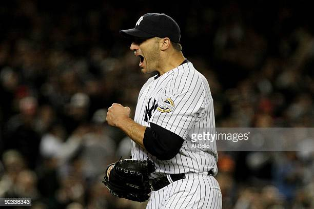 Andy Pettitte of the New York Yankees celebrates the end of the top of the sixth inning of Game Six of the ALCS against the Los Angeles Angels of...
