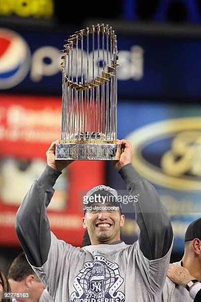 Andy Pettitte of the New York Yankees celebrates with the trophy after their 73 win against the Philadelphia Phillies in Game Six of the 2009 MLB...