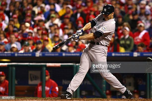 Andy Pettitte of the New York Yankees connects for a single against the Philadelphia Phillies in Game Three of the 2009 MLB World Series at Citizens...