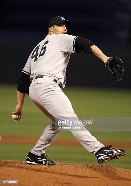 Andy Pettitte of the New York Yankees delivers the ball against the Minnesota Twins in Game Three of the ALDS during the 2009 MLB Playoffs at the...