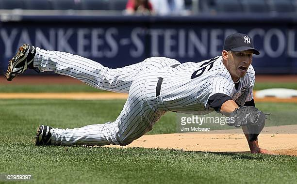 Andy Pettitte of the New York Yankees fields a ball bunted by Carl Crawfor of the Tampa Bay Rays during the first inning on July 18 2010 at Yankee...