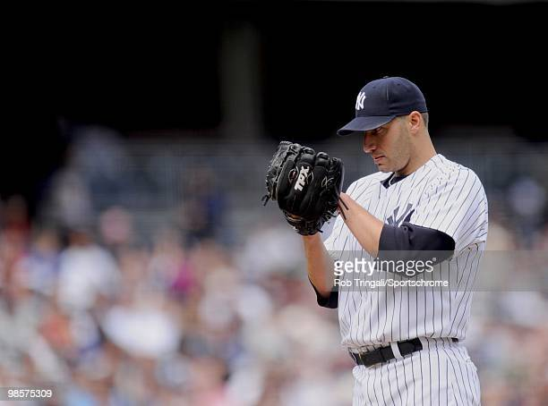 Andy Pettitte of the New York Yankees looks for a sign from his catcher against the Texas Rangers at Yankee Stadium on April 18 2010 in the Bronx...