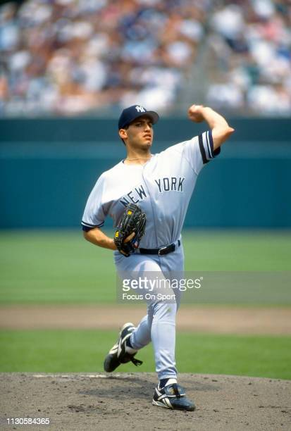Andy Pettitte of the New York Yankees pitches against the Baltimore Orioles during an Major League Baseball game circa 1995 at Oriole Park at Camden...