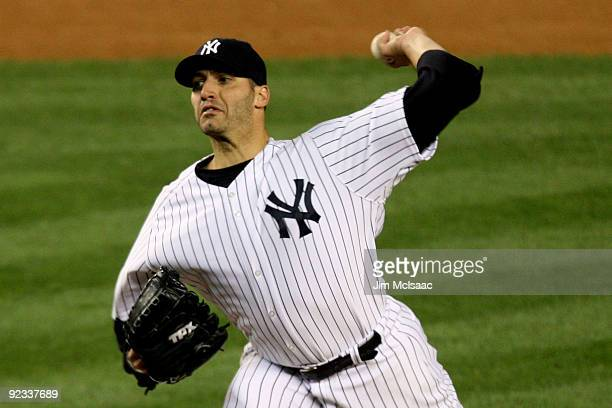 Andy Pettitte of the New York Yankees pitches against the Los Angeles Angels of Anaheim in the top of the third inning of Game Six of the ALCS during...