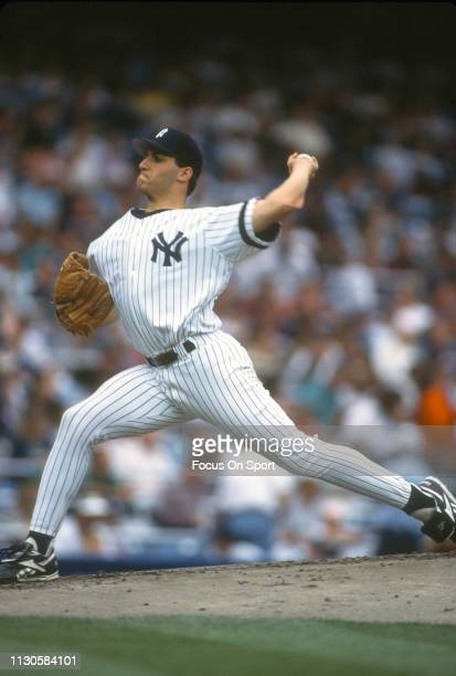 Andy Pettitte of the New York Yankees pitches during an Major League Baseball game circa 1995 at Yankee Stadium in the Bronx borough of New York City...