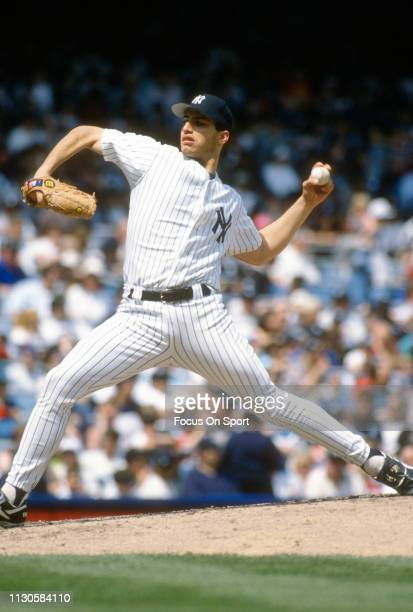 Andy Pettitte of the New York Yankees pitches during an Major League Baseball game circa 1996 at Yankee Stadium in the Bronx borough of New York City...