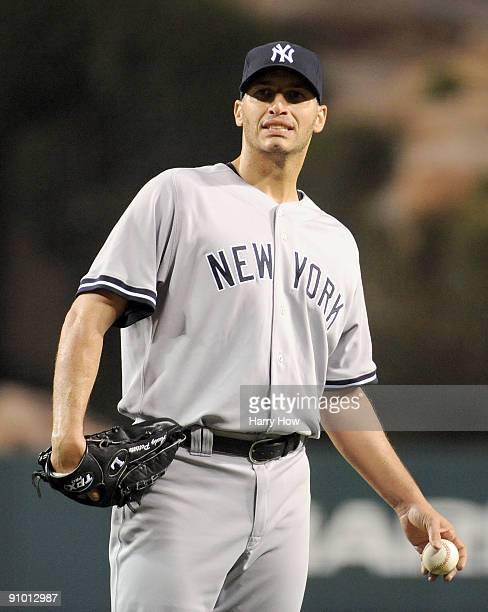 Andy Pettitte of the New York Yankees reacts after allowing the first run to the Los Angeles Angels of Anaheim to trail 01 during the first inning at...