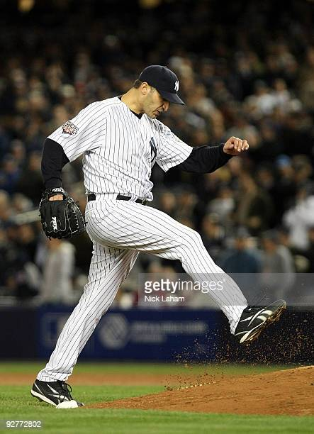 Andy Pettitte of the New York Yankees reacts after he gave up a 2run home run against Ryan Howard of the Philadelphia Phillies in the top of the...