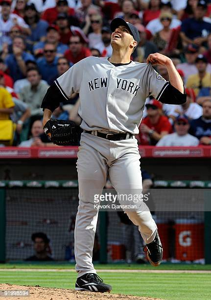 Andy Pettitte of the New York Yankees reacts after Vladimir Guerrero of the Los Angeles Angels of Anaheim hit a two run home run during the sixth...