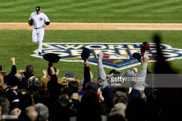 Andy Pettitte of the New York Yankees runs back to the dugout after he was taken out of the game in the top of the sixth inning against the...