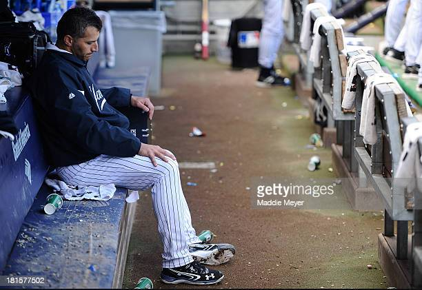 Andy Pettitte of the New York Yankees sits in the dugout after being pulled in the eighth inning against the San Francisco Giants during interleague...