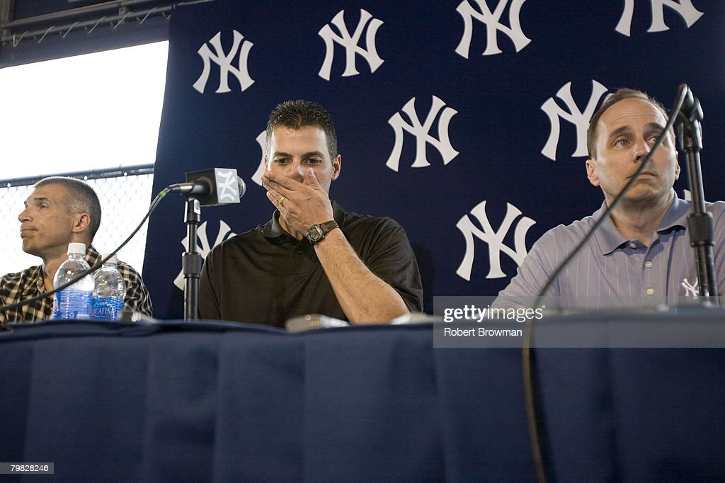 Andy Pettitte (C) of the New York Yankees speaks to the media during his press conference to discuss his HGH (Human Growth Hormone) use as Manager Joe Girardi (L) and General Manager Brian Cashman look on, February 18, 2008 at Legends Field in Tampa, Florida.
