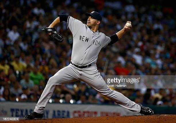 Andy Pettitte of the New York Yankees throws a pitch in the second inning against the Houston Astros at Minute Maid Park on September 28 2013 in...
