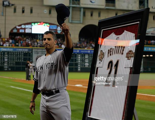 Andy Pettitte of the New York Yankees waves to the crowd after he was given an Astros jersey by the team during the fifth inning of the game against...