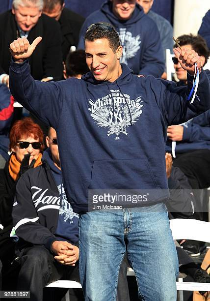 Andy Pettitte of the New York Yankees waves to the crowd after accepting his key to the city at the New York Yankees World Series Victory Celebration...