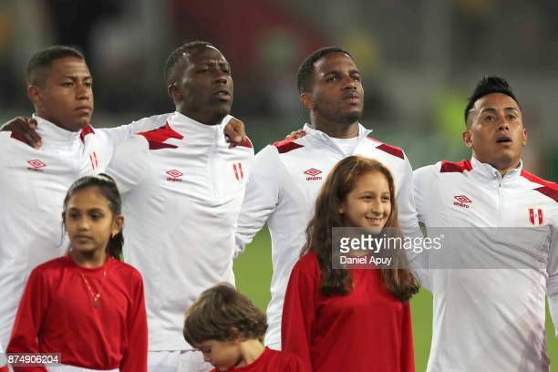 Andy Polo Luis Advincula Jefferson Farfan and Christian Cueva of Peru sing their national anthem prior a second leg match between Peru and New...