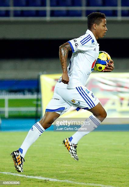 Andy Polo of Millonarios celebrates a scored goal during a match between Aguilas Doradas and Millonarios as part of 11th round of Liga Postobon 2014...