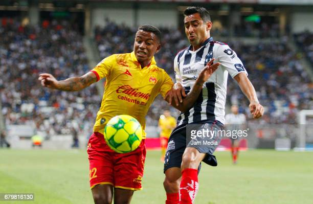 Andy Polo of Morelia and Luis Fuentes of Monterrey fight for the ball during the 17th round match match between Monterrey and Morelia as part of the...