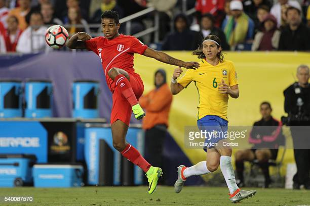 Andy Polo of Peru clears the ball as Filipe Luis of Brazil looks on during the Brazil Vs Peru Group B match of the Copa America Centenario USA 2016...