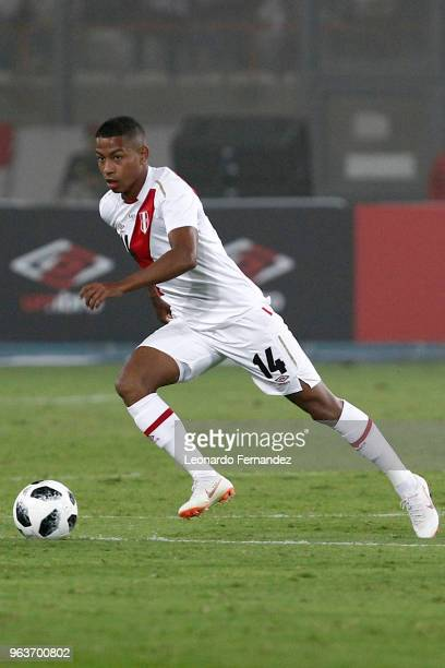 Andy Polo of Peru drives the ball during the international friendly match between Peru and Scotland at Estadio Nacional de Lima on May 29 2018 in...