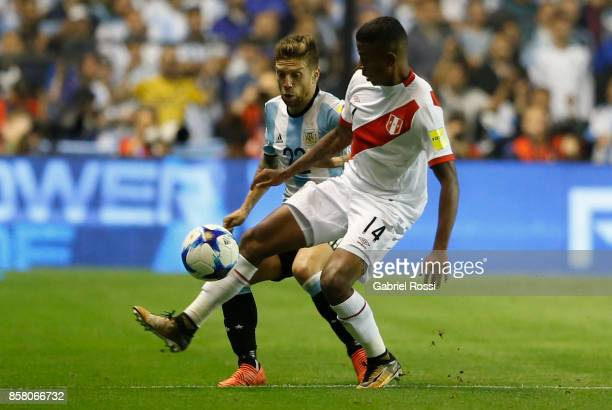 Andy Polo of Peru fights for the ball with Alejandro Gomez of Argentina during a match between Argentina and Peru as part of FIFA 2018 World Cup...
