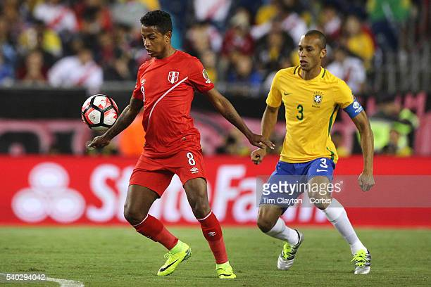 Andy Polo of Peru is challenged by Miranda of Brazil during the Brazil Vs Peru Group B match of the Copa America Centenario USA 2016 Tournament at...