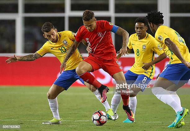 Andy Polo of Peru is stopped by Lucas Lima of Brazil during the 2016 Copa America Centenario Group B match between Brazil and Peru at Gillette...