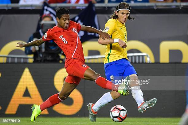 Andy Polo of Peru struggle for the ball against Filipe Luis of Brazil during the 2016 Copa America Centenario Group B match between Brazil vs Peru at...