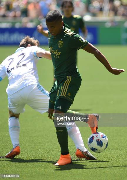Andy Polo of Portland Timbers brings the ball up the pitch on Magnus Eikrem of Seattle Sounders during the first half of the game at Providence Park...