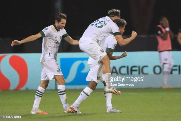 Andy Polo of Portland Timbers celebrates with teammates Bonilla and Valeri after scoring the third goal of their team during a quarter final match of...
