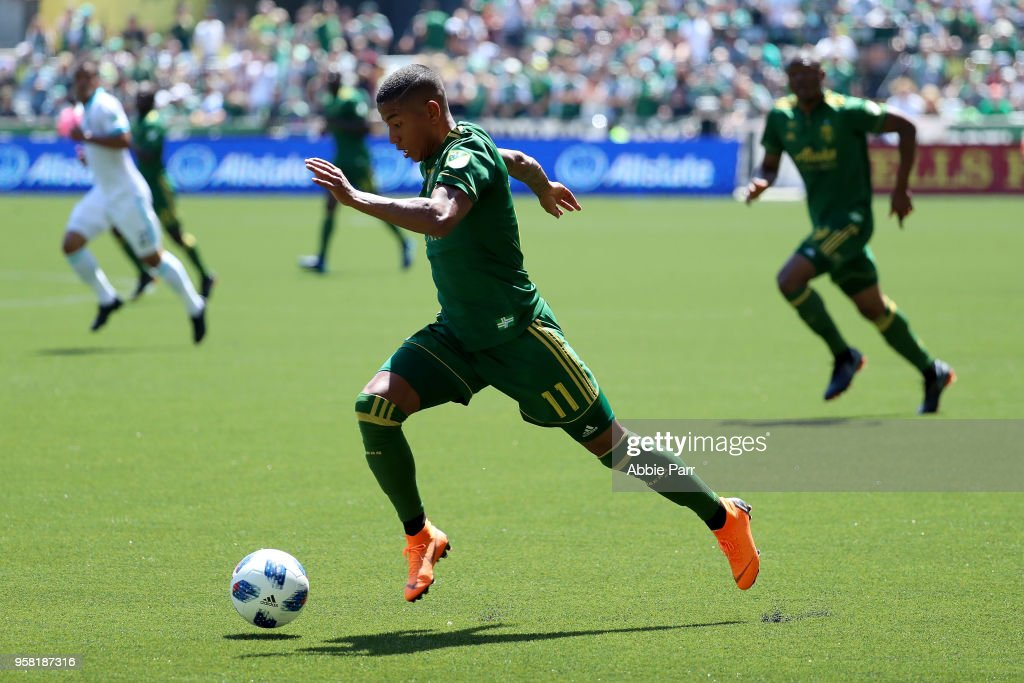 Andy Polo #11 of the Portland Timbers dribbles with the ball in the first half against the Seattle Sounders during their game at Providence Park on May 13, 2018 in Portland, Oregon.