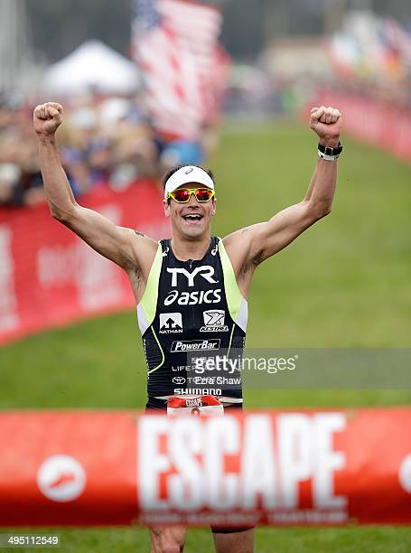 Andy Potts celebrates as he crosses the finish lie to win the 2014 Escape from Alcatraz Triathlon on June 1 2014 in San Francisco California
