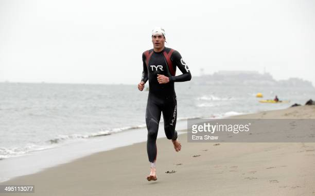Andy Potts exits the water during the 2014 Escape from Alcatraz Triathlon on June 1 2014 in San Francisco California Potts went on to win the race
